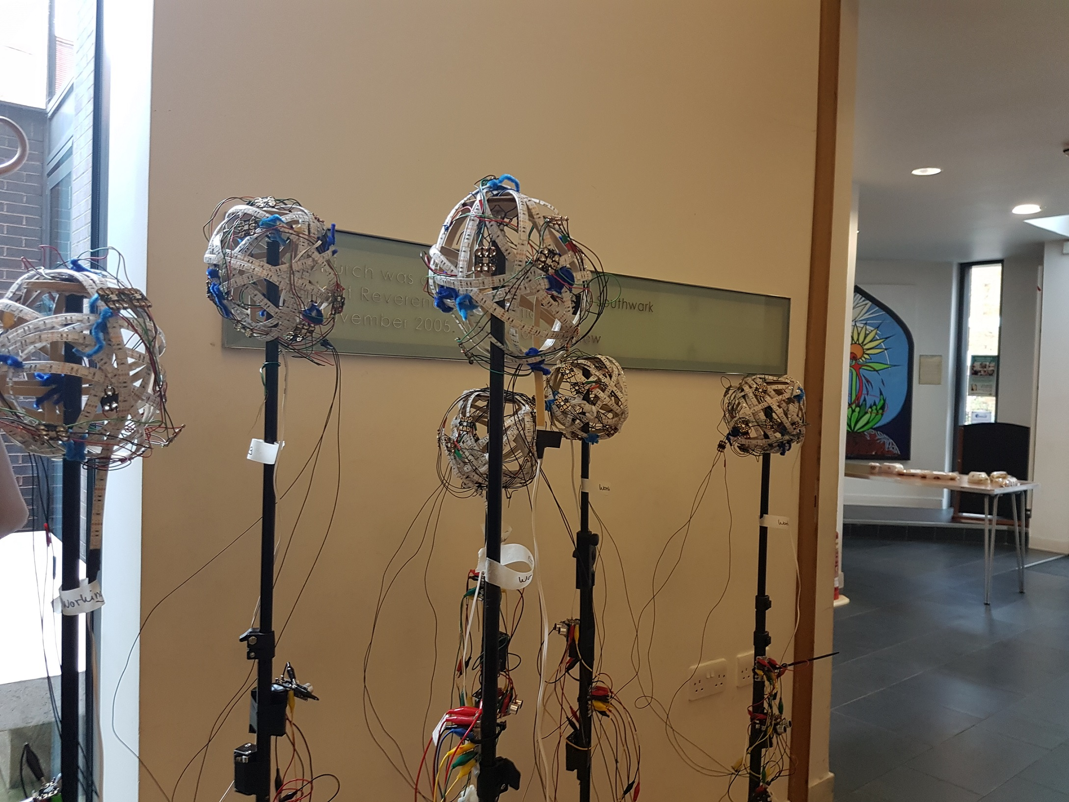 Balls of light were mounted on stands with the distance sensor and button.  Photo by Su Adams